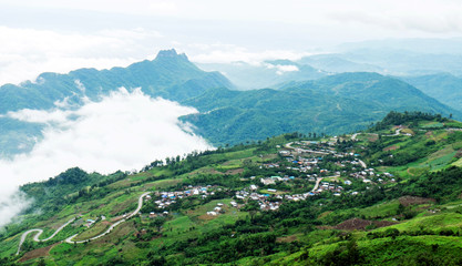 Beautiful view of village in the mountains with mist and road mountains