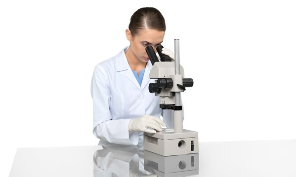 Scientist Working with Microscope isolated on white background