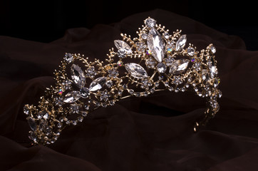 Wall Mural - gold diadem with diamonds isolated on the fabric
