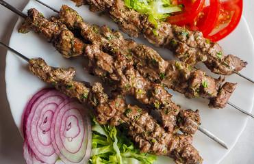 Traditional arabic lamb kebab with salad in morocco