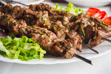 Traditional arabic lamb kebab with salad in morocco
