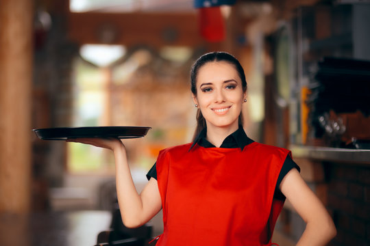 Smiling Waitress Holding Tray in a Restaurant