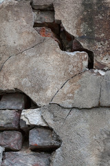 Large cracks in the stone wall