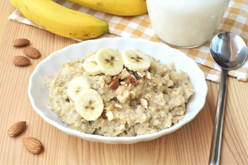 Oatmeal with banana and almond nuts, healthy breakfast.