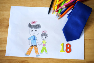 Happy child us a color pencil drawing father and son greeting card for Father's Day.