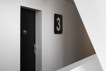 Entrance door to modern European apartment background, New apartment three symbol, Concept of new housing