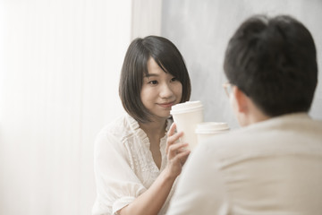 the girl is talking to man