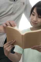 the couple is reading book