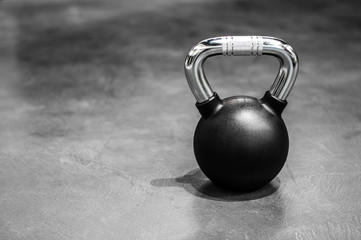 health and sport lifestyle concept, steel athletic kettlebell weight in a black shell