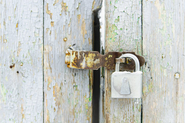 Padlock on the old door