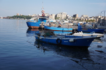 Fishing boats moored in the harbour of the Italian city Taranto