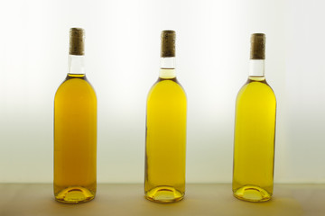 Three bottles of white wine with different tones