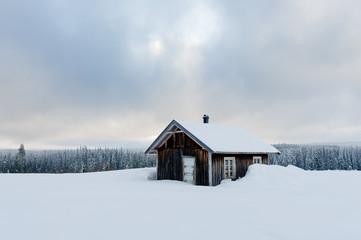 Old mountain cabin in winter landscape, Norway