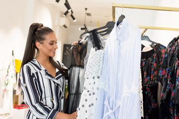 Woman in shopping. Happy woman enjoying in shopping. Consumerism, shopping concept