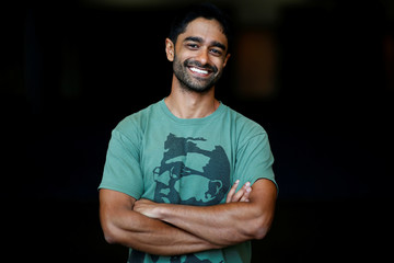 Saikat Chakrabarti, President of Justice Democrats and senior advisor to Alexandria Ocasio-Cortez, poses for a photo at the Netroots Nation annual conference for political progressives in New Orleans
