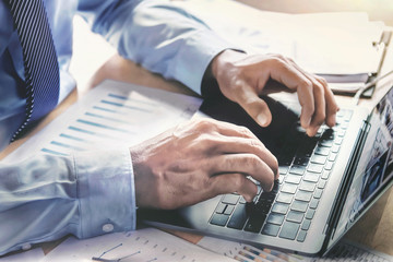 businessman using laptop working in office. concept finance and accounting