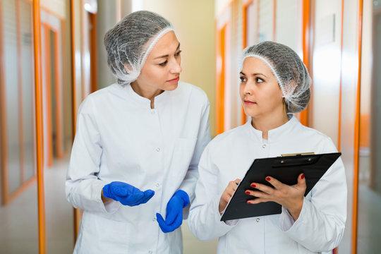 Female doctors discussing beauty procedures