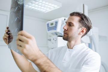 Technician Examining X-ray Films