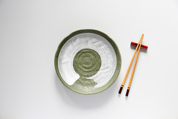 Ceramic plate green and wood Chopsticks oriental style,Copy space,Flat lay