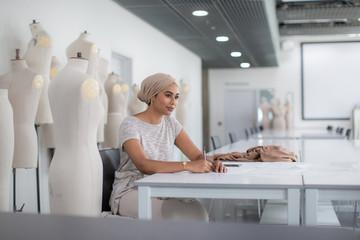 Muslim female fashion designer working on ideas