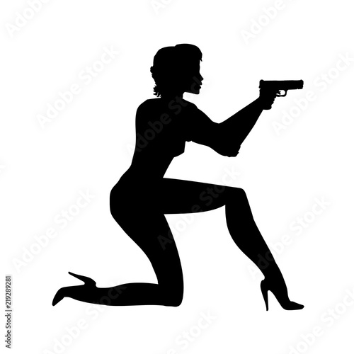 silhouette girl in an action movie film shootout pose with a gun sit