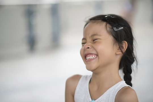 Adorable little girl laughing in the street