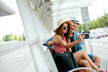 Travel. Couple Taking Photos On Phone Near Airport