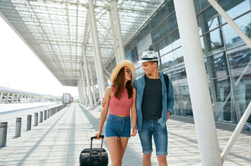 People Travel. Couple Near Airport, Traveling On Vacations