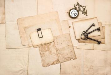 Vintage letters keys pocket watch Flat lay paper background