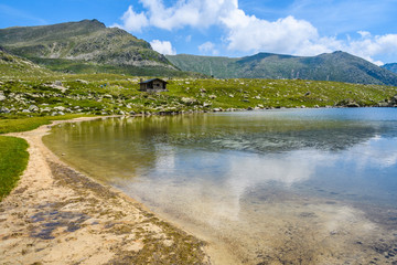 Sandy beach on Montmalus Lake in Andorra
