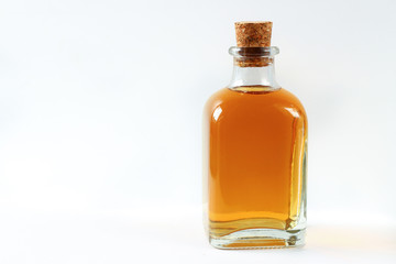 Red rowanberry bottle with tincture on a white background