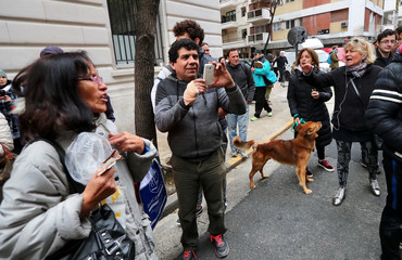 Two women argue with supporters of former Argentine President and senator Cristina Fernandez de Kirchner outside her home in Buenos Aires