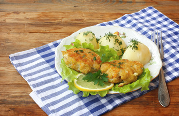 homemade fish cutlets with potatoes in plate