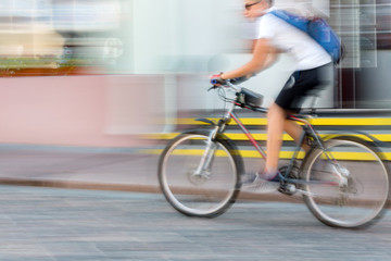 Man riding bicycle in the city, motion blur