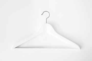 Empty wooden hangers for clothes