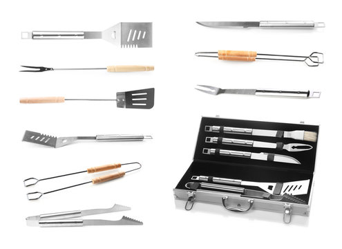 Set with barbecue utensils on white background