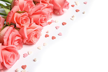 Beautiful roses and little hearts on white background