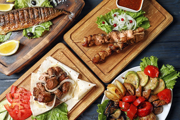 Flat lay composition with tasty grilled dishes on table