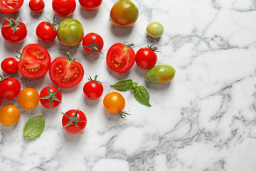 Flat lay composition with juicy tomatoes on marble background