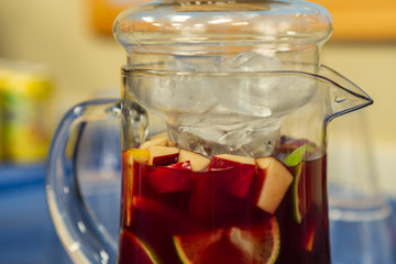 Sangria wine with fruits in jug