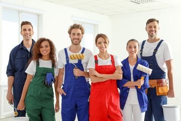 Team of professional painters with tools indoors