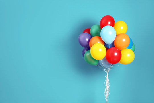 Bunch of bright balloons and space for text against color background