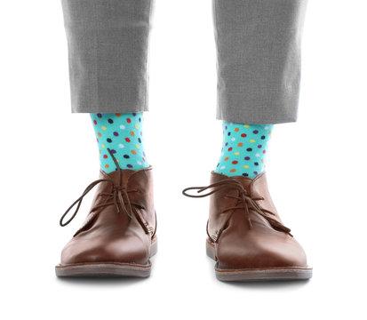 Man wearing stylish socks and shoes on white background, closeup