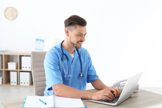 Male medical assistant at workplace in clinic. Health care service