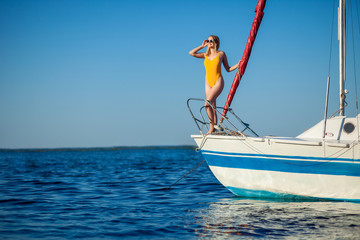 Girl resting on a yacht, a sailboat