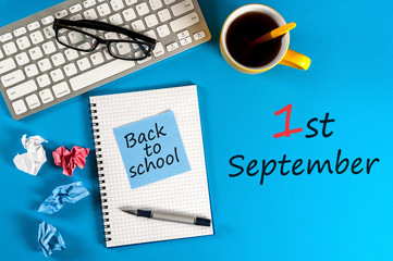 September 1st - Back to school concept on a blue background with the supplies for study.