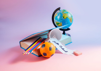 Back to school concept. Globe with school supplies.