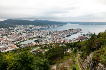Panoramic view of Bergen and harbor from Mount Floyen, Bergen, Norway. Panorama of Bergen from the viewport on the mountain. The Norwegian city with a port in the evening. City landscape.