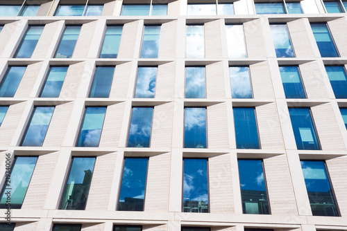 big glass windows bedroom facade of modern style office building with multiple big glass windows