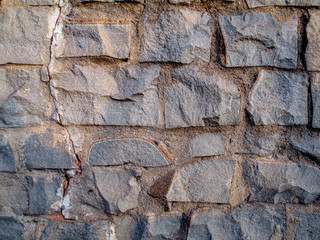 wall of gray stones, pattern, texture, lit by the sun